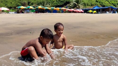 Magnificent Kalacha Beach in Goa - Delighted baby
